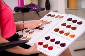 Customer choosing colour for her hair