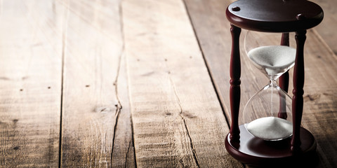 Vintage Hourglass On Wooden Plank Background /Time Concept