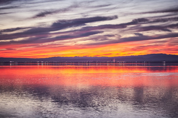 Sunset in the calm waters of the Albufera de Valencia, Spain.