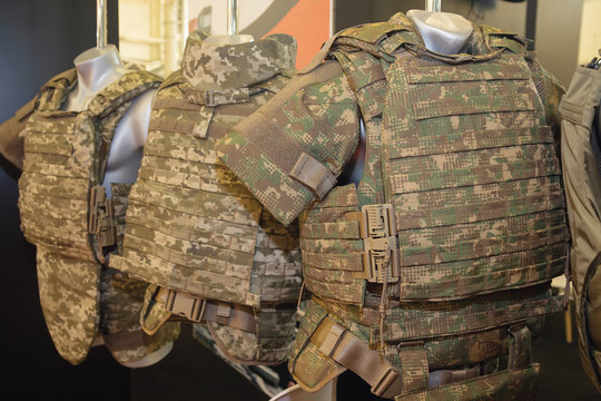Army camouflaged body armor in the store. Weapons