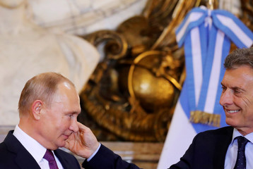 Russia's President Vladimir Putin meets with Argentina's President Mauricio Macri at the Casa Rosada Presidential Palace in Buenos Aires