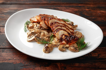 Grilled slices Chicken Breast with Creamy Mushroom Sauce. healthy food