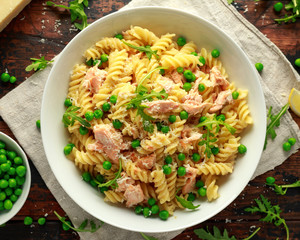 Homemade Pasta fusilli with salmon, green peas, parmesan cheese and lemon. healthy food. background.