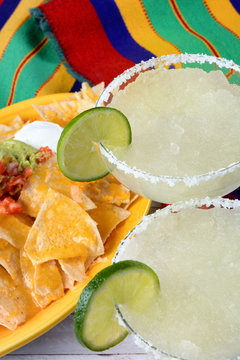Cinco de Mayo Concept: Margaritas and Mexican food on a colorful  table cloth.