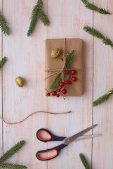 Christmas gift boxes and fir tree branch on wooden table, flat lay. Сhristmas background