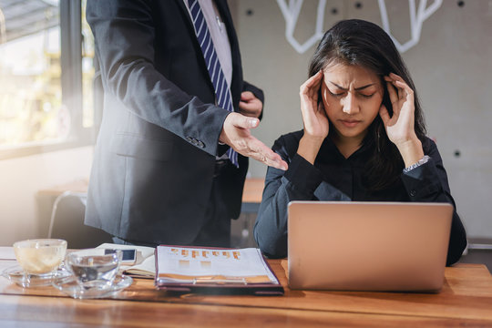 The boss blamed the secretary on her work and had a headache in office.