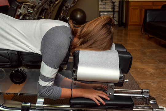 Side View of a Girl Laying on a Tilted Chiropractic Table