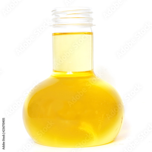 Transparent glass open flask with yellow vegetable sunflower