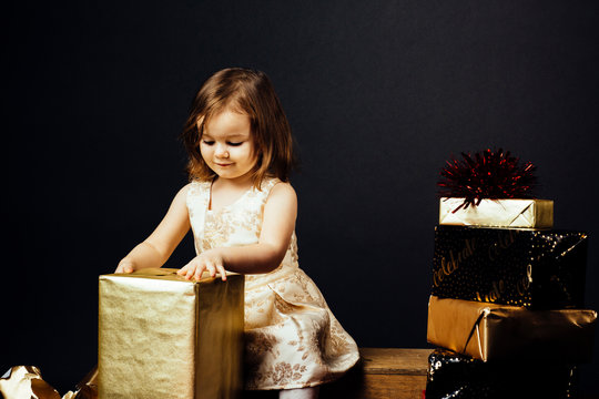Portrait of a small toddler girl isolated on black studio background