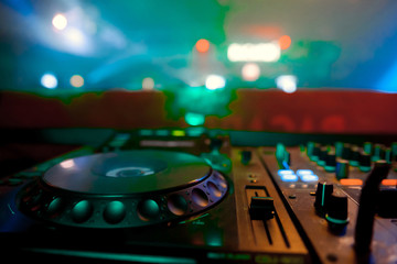 DJ sound equipment at nightclubs and music festivals, EDM, future house music and so on. Parties concept, sound technique. DJ playing on the best
