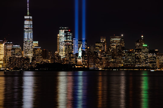 9/11 Memorial Beams with Statue of Liberty and Lower Manhattab
