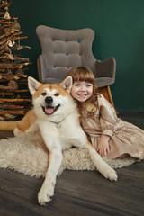 Girl child dog husky new year tree smile portrait friendship animals holiday