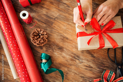 Christmas Gift Wrapping Station.Diy Gift Wrapping Woman Filling Out Christmas Gift Tag On