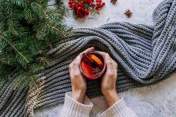 Christmas and New Year's mulled wine in female hands. Top view.