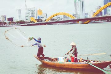 Fisherman of lake in action when fishing.