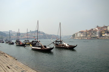 Boats with barrels of wine on the Douro river in Porto