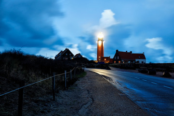 Fototapete - road to red lighthouse in night