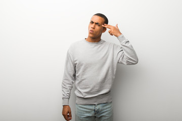 African american man on white wall background with problems making suicide gesture