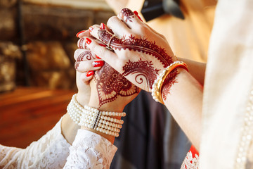 newlyweds hold each other's hands with golden rings