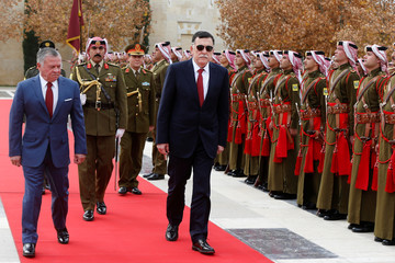 Jordan's King Abdullah II and Fayez al-Sarraj, Libya's Prime Minister review Bedouin honour guards at the Royal Palace in Amman