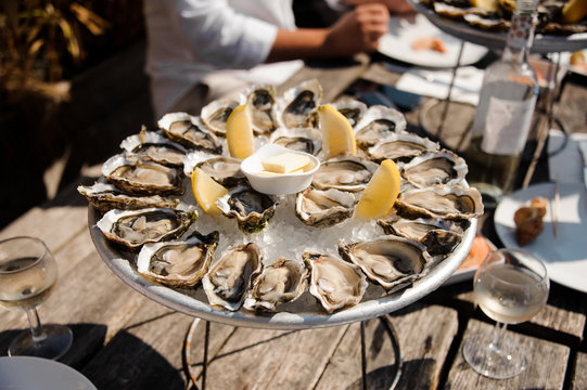 Tasty oysters on the plate on the table