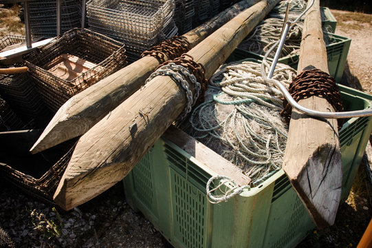 Wooden stakes with ropes on the plastic box