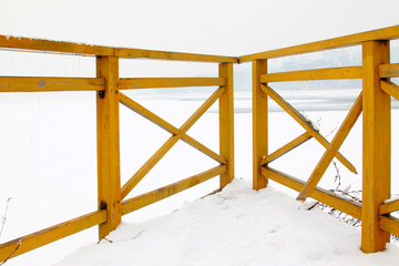 Wooden baluster in the snow