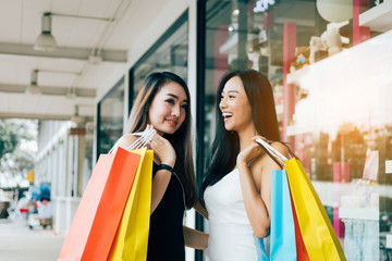 Teenager asian women walking and doing shopping together.