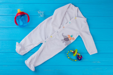White footie baby sleepwear and toys.