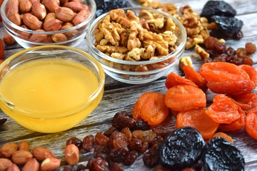Dried fruits and honey on wooden background.Healthy.