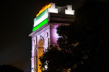 A night view of illuminated India Gate with the Indian flag lighted on it