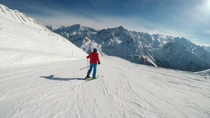Fototapete - Man skiing on the prepared slope with fresh new powder snow in Italian Alps, Tonale