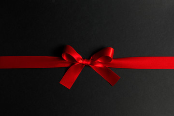 Wall Mural - Red gift bow on black