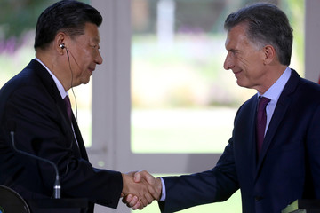 Argentina's President Mauricio Macri and his China's counterpart Xi Jinping shake hands before the news conference after their meeting at the Olivos Presidential Residence in Buenos Aires