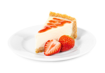 Piece of cheesecake with fresh strawberries on white plate
