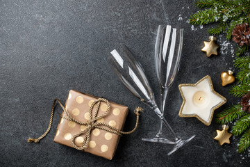 Christmas and New Year background with gift box, champagne glasses and decorations