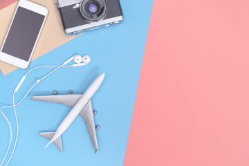 Travel top view gadgets and objects for business traveler on blue yellow pink copy space
