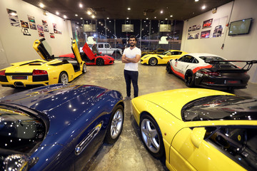 "Abdulla Al Brahim, owner of ""By Design Motorsports"", an auto advance tuning garage, poses for a photograph in his garage in Al Khobar"