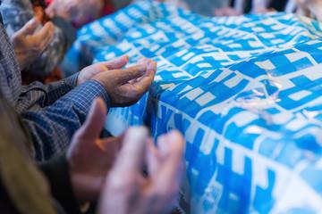 Muslim man hands praying. Shallow DOF