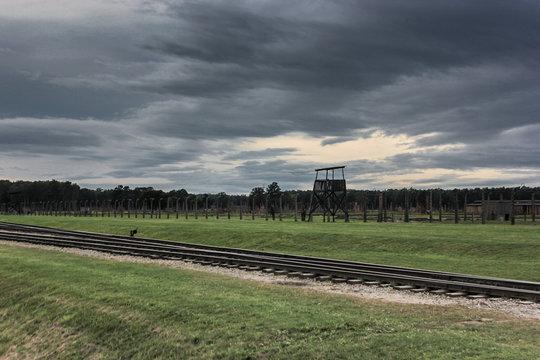 Railway and guard tower running through Auschwitz-Birkenau