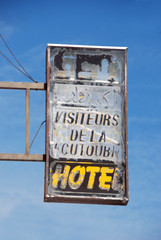 Hotel sign in ghost town Morocco