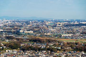 Aerial view of Tokyo apartments in cityscape background. Residential district in smart city in Asia. Buildings at noon. Japan