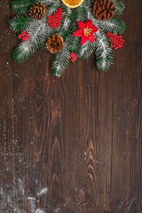 Christmas fir tree with decoration on dark wooden board. with copy space for text. Christmas mock-up or greeting card