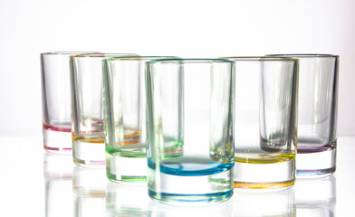 Six small colorful glasses on a white background