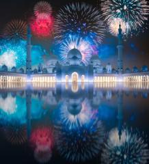Beautiful fireworks above Sheikh Zayed Grand Mosque at sunset Abu-Dhabi, UAE