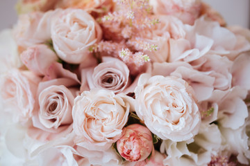 Wedding flowers, bridal bouquet closeup. Decoration made of roses, peonies and decorative plants, close-up, selective focus, nobody, objects