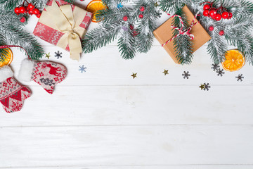 Old wood background with fir branches. Holiday Gifts. Christmas card. Top view. Gifts boxes with fir branches on wooden background