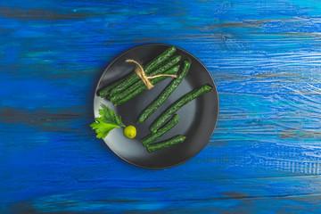 Kabanosy, sausages green with wasabi