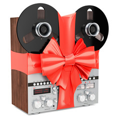 Retro reel-to-reel tape recorder with bow and ribbon, gift concept. 3D rendering