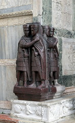 Venice, Italy. Monument of Four Tetrarchs late roman emperors at the corner of Saint Mark Basilica in Venice